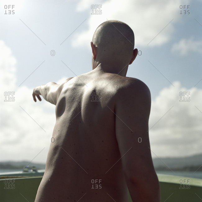 Man pointing into the distance on a boat