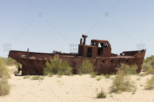 Aral Sea, Uzbekistan - June 8, 2016: Abandoned boats rusting in the former Aral Sea