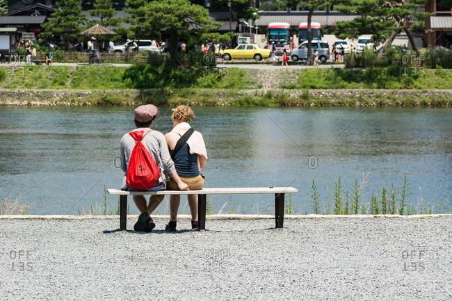 KYOTO, JAPAN - JULY 18, 2016: People resting at Arashiyama riverside park, Kyoto