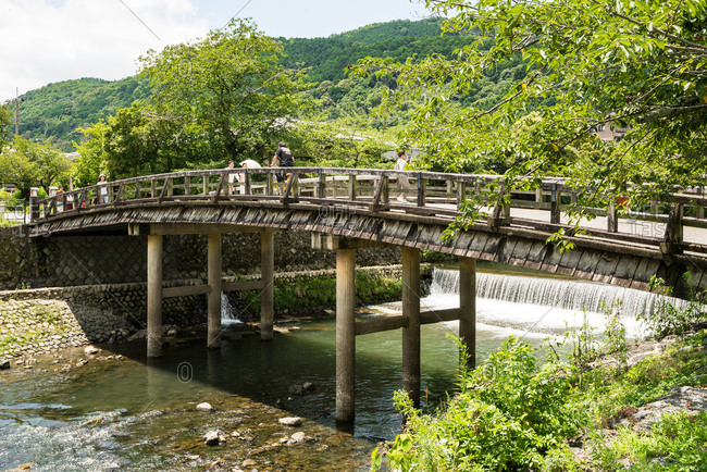 Kyoto, JAPAN - July 18, 2016: Old wooden bridge at Arashiyama riverside park, Kyoto