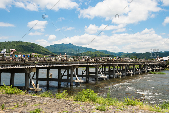 Kyoto, JAPAN - July 18, 2016: Togetsukyo bridge (Moon crossing bridge) in Arashiyama district, Kyoto