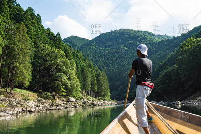 KYOTO, JAPAN - JULY 18, 2016: Boatman punting the boat for tourists in Arashiyama Kyoto, Japan