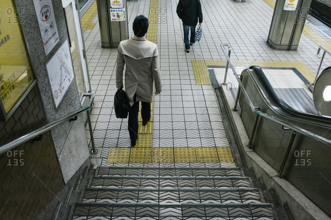Osaka, JAPAN - February 24, 2017: Business man walking in subway