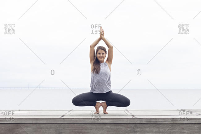 Woman balancing in a yoga pose on her toes