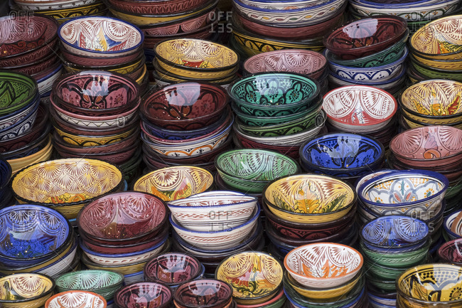 Morocco, Marrakech. Colorfully painted ceramic bowls for sale in a souk, a shop