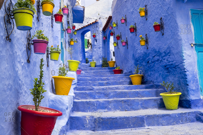 North Africa, Morocco, Chefchaouen or Chaouen is most noted for its small narrow streets and neighborhoods painted in variety of vivid blue colors. Plantings in colorful pots line the narrow corridors