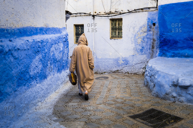 North Africa, Morocco, Chefchaouen or Chaouen is the chief town of the province of the same name. It is most noted for its small narrow streets and neighborhoods painted in variety of vivid blue colors. Moroccan in traditional costume