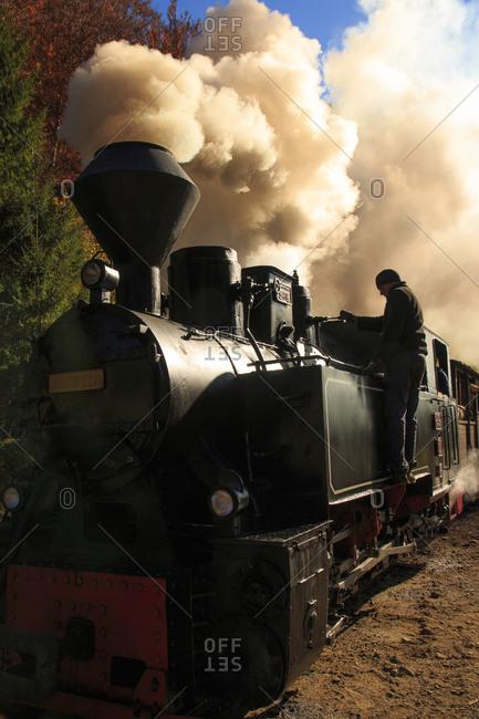 Europe, Romania - November 5, 2015: Romania, Viseu de Sus. Carpathian Forest Steam train. Vaser Valley Railway. Wood-burning, steam locomotive. Narrow-gauge railway. Initiated 1932