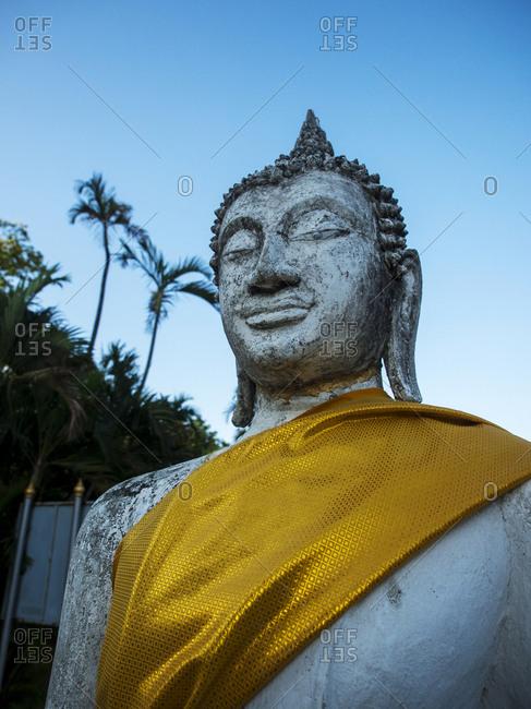 Thailand, Ayutthaya, Buddha Draped with Orange