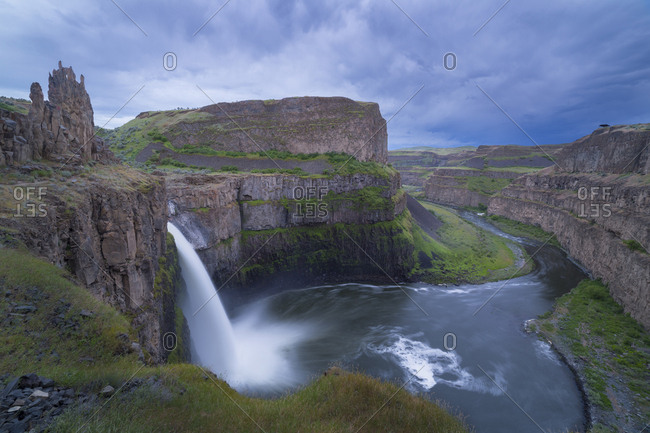 USA. Washington State. Palouse Falls in the spring, with an approaching storm, at Palouse Falls State Park