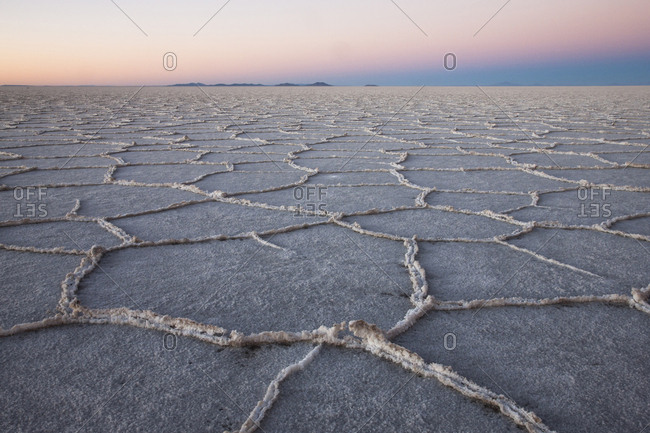The largest salt flats in the world located in Uyuni, bolivia as the sun is rising in winter
