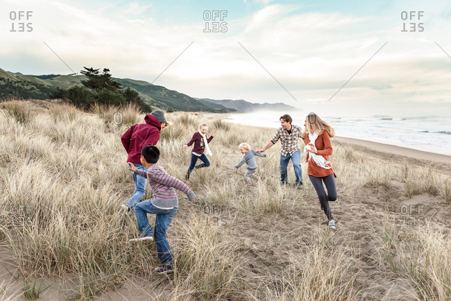 Family having fun near the ocean