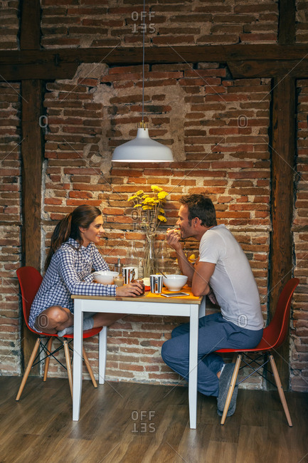 Young Couple Having Breakfast in a Rustic Apartment