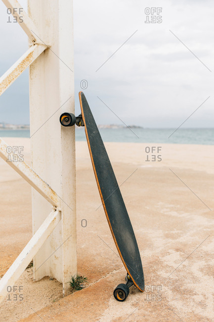 Lovely close view of long board on shore.