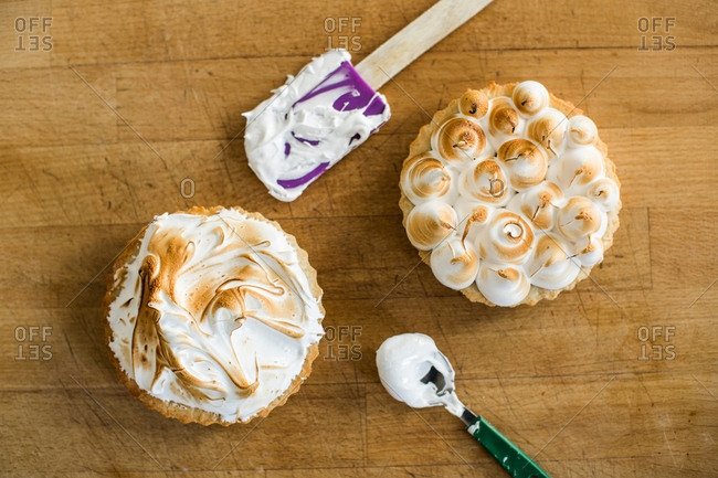 From above two fresh tarts with burnt meringue on top Horizontal studio shot