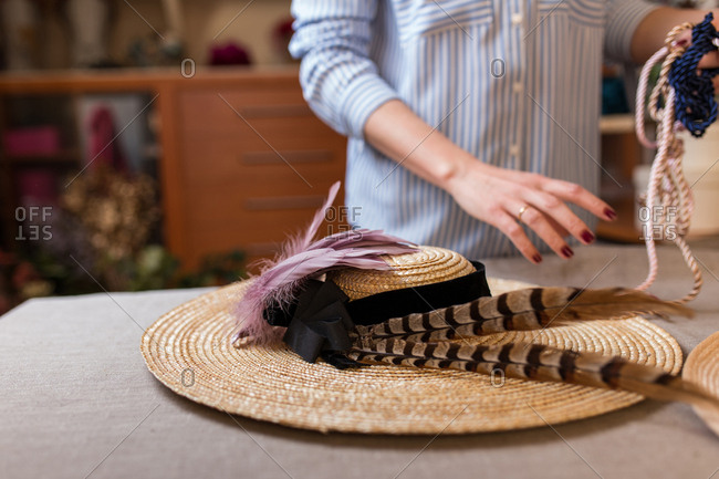 Crop person working in craft shop