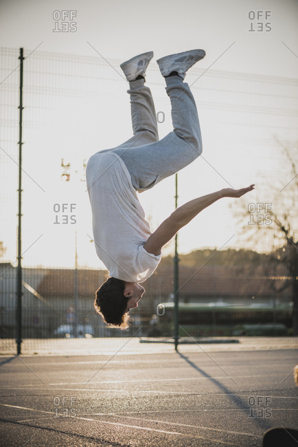 Man performing a backflip - Offset