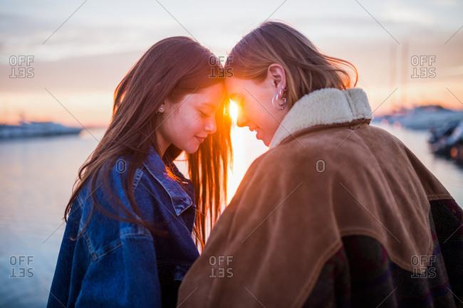 Cute couple of women having fun at sunset