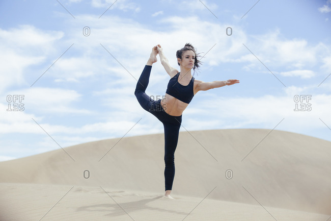Sportive woman practicing yoga