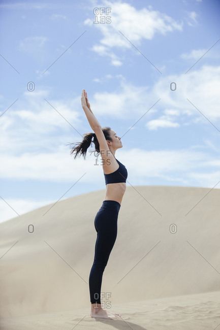 Peaceful woman in yoga pose