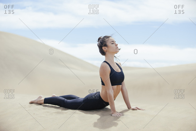 Peaceful woman in yoga pose