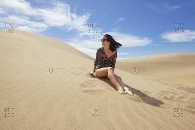 Woman in summer outfit - sarong - in the dunes
