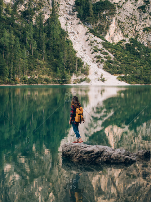 Woman with backpack in nature