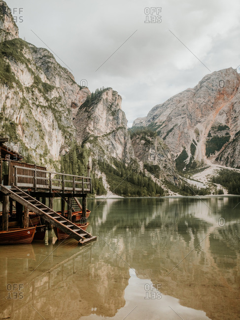 Wooden dock on lake in mountains