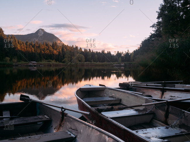 Few boats on shore of lake in Dolomites, Italy
