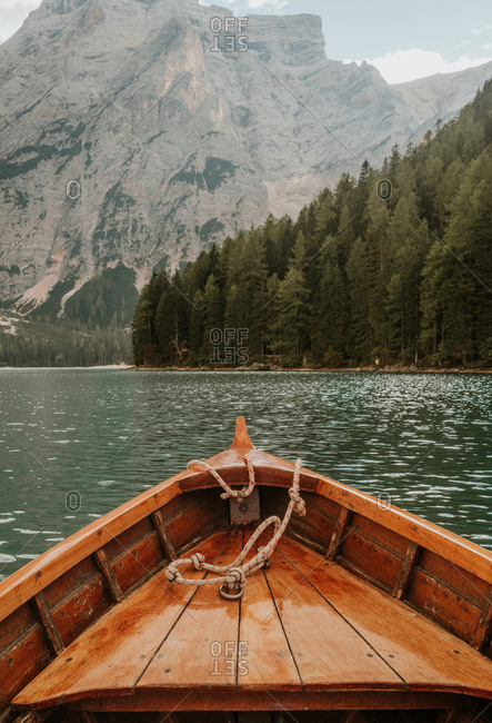 Crop wooden boat on lake