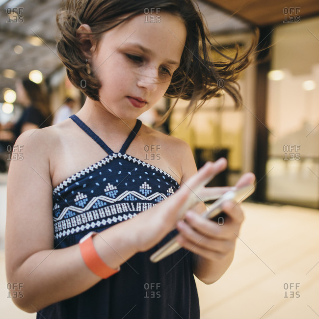 Young girl texting on a cell phone