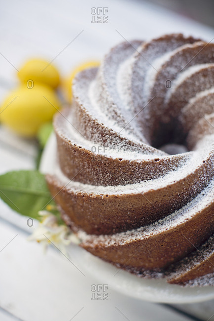 Close up of a bundt cake with powdered sugar