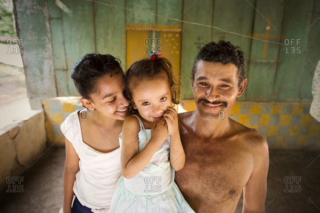A mad with his two young daughters