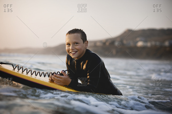 A young boy body boarding