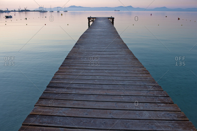 A wooden pier at sunset