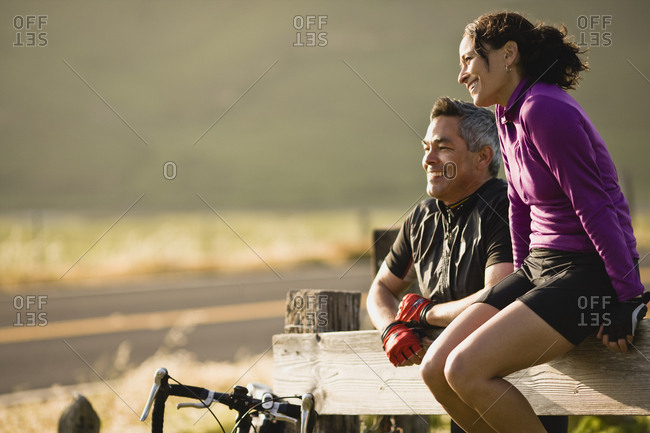 A couple taking a break during a bike ride through the country