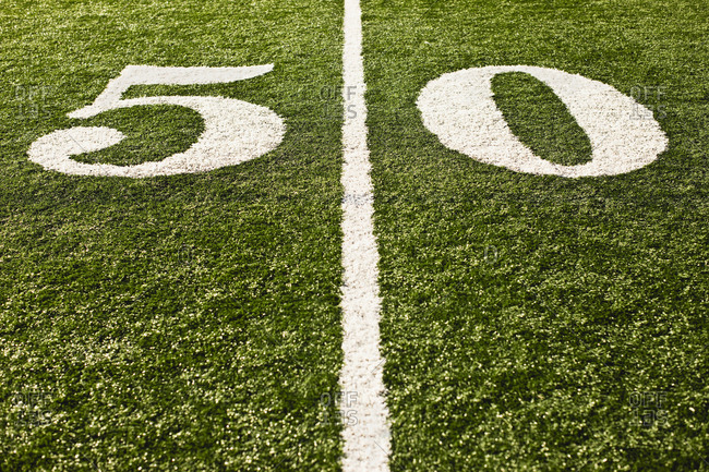 The fifty yard line on a football field