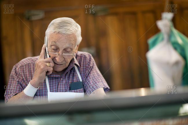 A senior man talking on a cell phone