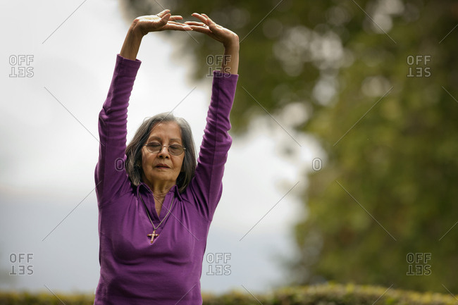 A senior woman practicing yoga