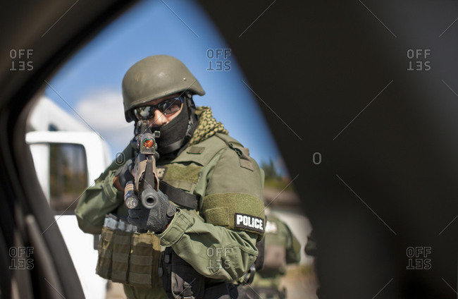 A military policeman aiming his gun
