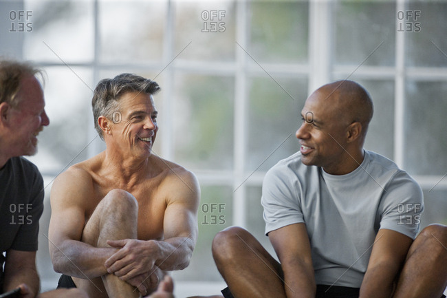 A group of friends talking before an exercise class