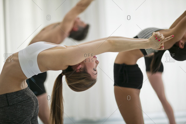 A group of people in a yoga class