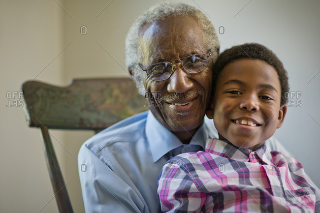 A grandfather and grandson sitting on a rocking chair