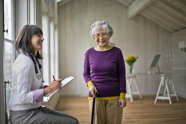 A smiling doctor and senior patient