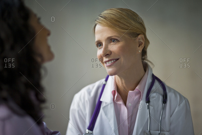 A doctor and nurse talking together