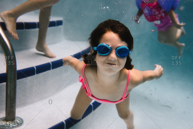 Young girl swims underwater