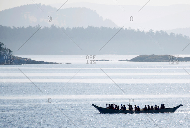 Victoria, British Columbia, Canada - July 28, 2017: First Nations war canoe paddling in the waters of the Strait of Georgia