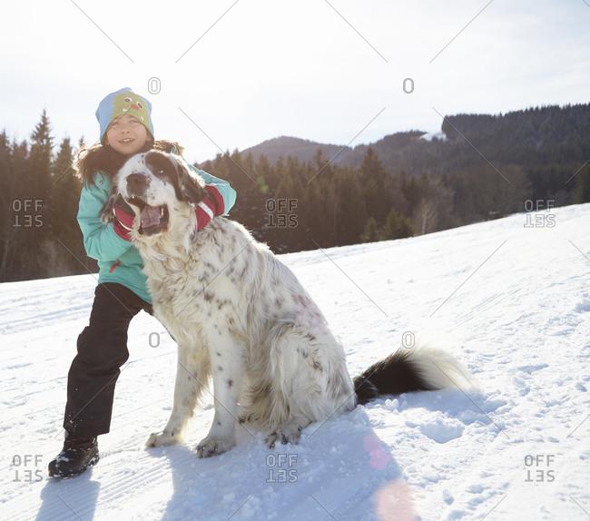 Girl bonding with her pet dog