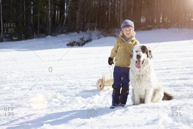 Boy bonding with his pet dog
