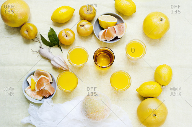 Assorted citrus fruits with glasses of fresh juice